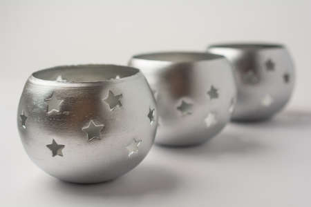 Tealight Candles with Stars on White Background Side View Stock Photo