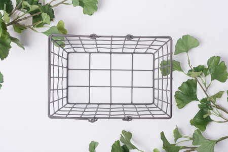 Metal Wire Basket with Branches Flat Lay Top View