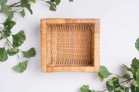 Wicker Basket with Branches Flat Lay Top View Stock Photo