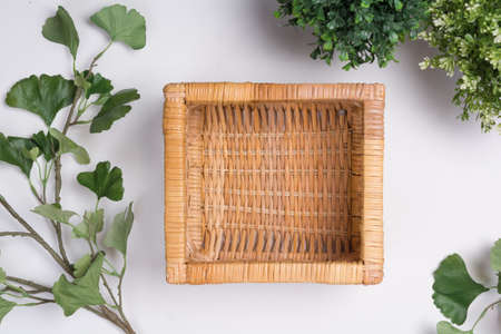 Wicker Basket with Foliage Flat Lay Top View Stock Photo