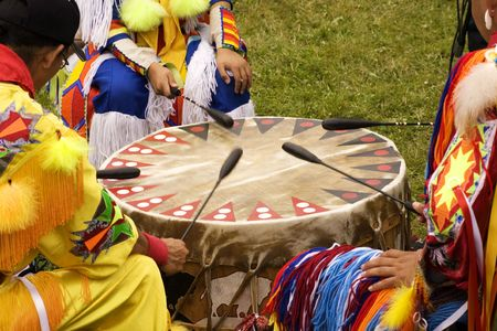 drum: Indians around a drum at a Pow Wow Indians druming Stock Photo