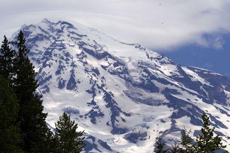 Eagles flying up near summit of Mount Rainier Stock Photo