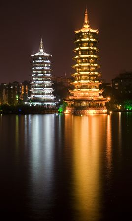 Sun, gold, and Moon, silver, Pagodas, Guilin, Guangxi, China at Night with Reflection photo