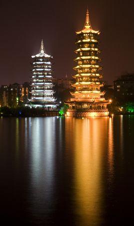 Sun, gold, and Moon, silver, Pagodas, Guilin, Guangxi, China at Night with Reflection