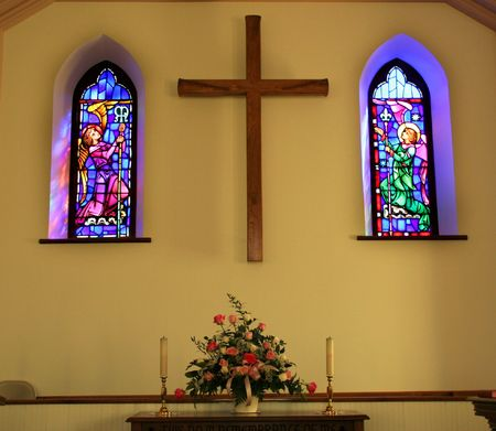 Church Interior With Stained Glass Windows, Cross and Altar