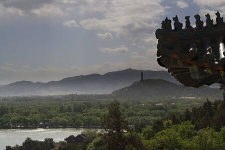 people's cultural palace: Roof of the Summer Palace on a blue day, Beijing, China with pagoda in the background Stock Photo