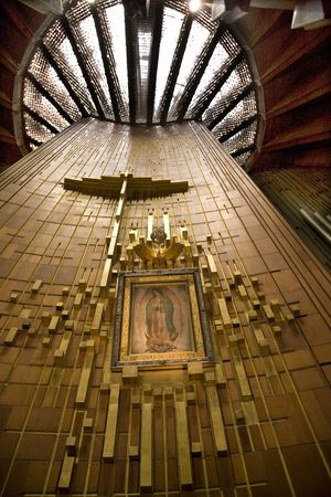 showed: Guadalupe Painting Hanging Over Altar, Guadalupe Shrine, Mexico City  This is the original painting that the Indian Peasant Juan Diego showed the Catholic Bishop in 1531. Stock Photo