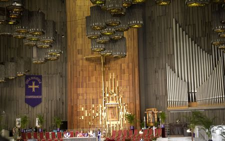 alter: Church Service, with painting of the Guadalupe Hanging above alter, Shrine of the Guadalupe, Mexico City