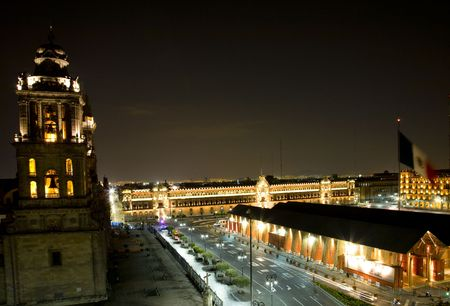 Metropolitan Cathedral and Presidents Palace in Zocalo, Center of Mexico City, with Flag at Night
