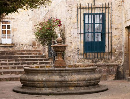 Small Courtyard Plaza with Fountain at end of Walking Street Morelia Mexico Reklamní fotografie