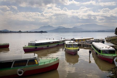 reviewer: Taxi boats Janitizo Island Patzcuaro Lake Mexico.  Boats take residents and tourists to shore.Resubmit--In response to comments from reviewer have further processed image to reduce noise and sharpen focus.