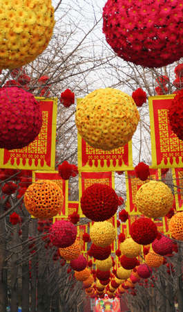 throughout: Chinese Lunar New Decorations, Ditan Park, Beijing China  At Lunar New Year time, there are temple fairs throughout Beijing and this is one of them.