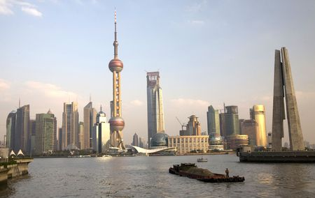 pudong: Shanghai Pudong TV Tower with Barge BoatTrademarks removed.