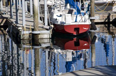 edmonds: Reflections of boats, water, pier, dock, Edmond Washington  Trademarks removed.