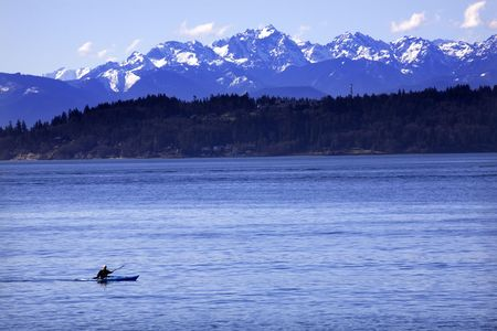 edmonds: Kayak, Kayaking, on Puget Sound with Snowy sports competition Mountains in background, Edmonds, Snohomish County, Washington Stock Photo