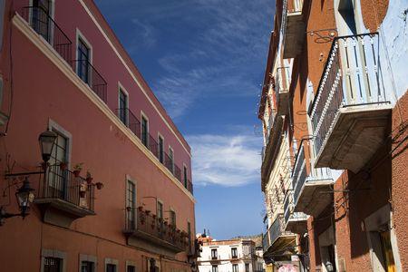 Street, Orange Abobe Wall, Flowers, Balconies, Blue Sky, Guanajuato, Mexico Stock Photo - 2911535