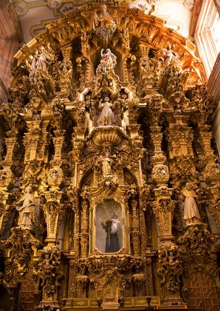 consecrated: Golden Ornate Altar Piece, Templo De San Cayetano, Valencia, Church, Guanajuato, Mexico.  This church was finished in 1788 and is named after the nearby Valencia mine.