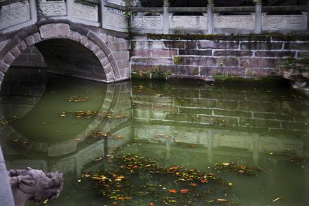 Old Stone Bridge, pond, reflections, wuhou memorial, three kingdoms, temple, chengdu, sichuan, china This temple was built in the 1700s and is an historical landmark in China. Stock Photo - 3180830