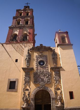 reviewer: Santo Domingo Church, Steeple, Bells, Facade, Front, Entrance, Queretaro, MexicorrResubmit--In response to comments from reviewer have further processed image to reduce noise and sharpen focus. Stock Photo