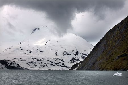 anchorage: Portage Glacier Snow Mountain Under Overcast Sky Anchorage Alaska Stock Photo