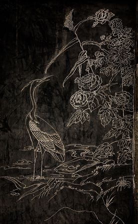 reviewer: Stone Engraving of Stork, bird, outside of Old Chinese , Jinli Street, Chengdu, Sichuan, China  Resubmit--In response to comments from reviewer have further processed image to reduce noise, sharpen focus, and adjust lighting.  Stock Photo