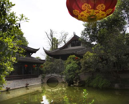 red lantern, stone bridge, pond, reflection, Wuhou Memorial, Three Kingdoms, Temple, chengdu, sichuan, china.  This Temple was built in the 1700s and is a historical landmark in China.