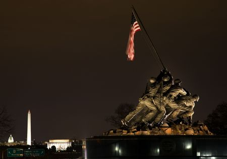 The Marine Corps War Memorial Shows the Raising of the Flag at Iwo Jima in World War II  Washington DC  Statue finished in 1954.  Lincoln Memorial, Washington Monument and Capital in the background.