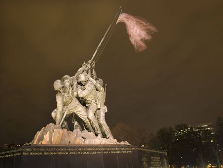 The Marine Corps War Memorial Shows the Raising of the Flag at Iwo Jima in World War II  Washington DC  Rosslyn Buildings in Background Statue finished in 1954
