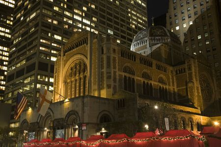 episcopal: Saint Bartholomews Episcopal Church Park Avenue New York City  Completed in 1930.  At night with Christmas Fair.  Trademarks removed.