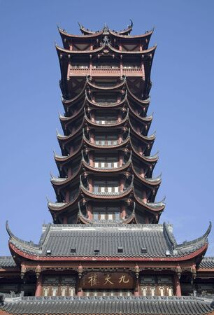 reviewer: Jiutian Pagoda Tower Chengdu Sichuan China   The pagoda was built in the early 1950s just after liberation of China.  Resubmit--In response to comments from reviewer have further processed image to reduce noise, sharpen focus and adjust lighting.   Stock Photo
