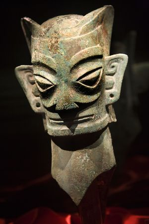 dated: Three Thousand Year Old Bronze Mask Statue Sanxingdui Three Star Mound Museum Guanghan Chengdu Sichuan China The statues have been carbon dated to the 11th-12th Century BCE.  Resubmit--In response to comments from reviewer have further processed image to
