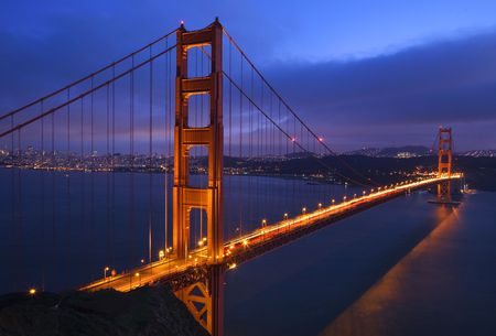 Golden Gate Bridge Sunset Pink Skies Evening with Lights of San Francisco California in background Stock Photo - 4219228