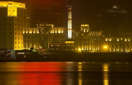 Old Weather Station, The Bund, Old Part of Shanghai, At Night Water Reflections  Resubmit--In response to comments from reviewer have further processed image to reduce noise, sharpen focus and adjust lighting.  photo