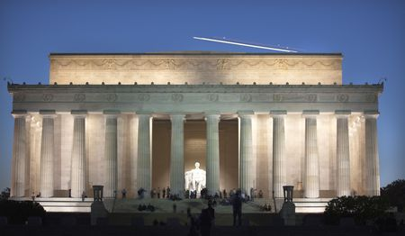 Airplane Over Lincoln Memorial White Statue Evening Washington DC Faces Blurred by Long Exposure photo