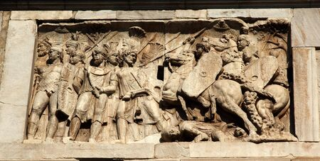 roman soldiers: Details Arch of Constantine Roman soldiers Rome Italy Stone arch was built in the year 315 to celebrate Constantines victory in 312 over co-emperor Maxenntius at Milvian Bridge.  Emperor Constantine attributed the victory to a dream which lead him to mar Stock Photo