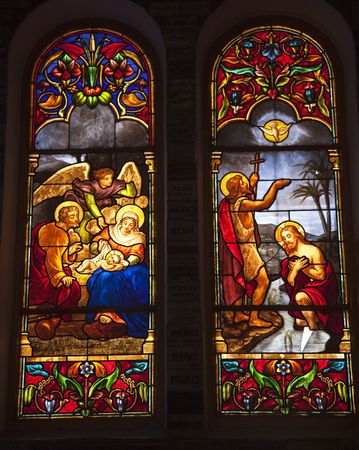 asian art: Notre Dame Cathedral, Nha Tho Duc Ba, build in 1883 largest cathedral in French Empire Stained Glass Jesus Birth Baptism Ho Chi Minh City Vietnam