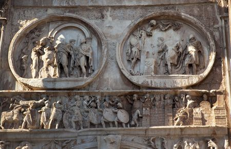 attributed: Details Arch of Constantine Rome Italy Stone arch was built in the year 315 to celebrate Constantines victory in 312 over co-emperor Maxenntius at Milvian Bridge.  Emperor Constantine attributed the victory to a dream which lead him to mark his mens shi Stock Photo