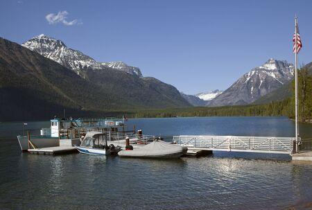 mcdonald: Lake McDonald Boats Snow Mountains at Glacier National Park Stock Photo