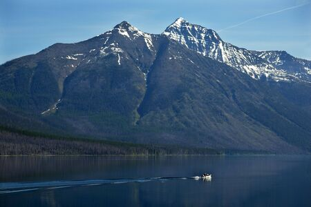 Lake McDonald Going Fishing Outboard in front of Snow Mountain Glacier National Park Montana photo