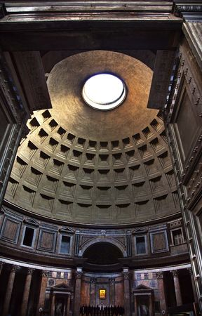 Pantheon Through Doors Cupola Oculus Ceiling Rome Italy Basilica Palatina First built in 27BC by Agrippa and rebuilt by Hadrian in the Second Century Became oldest church in 609 Oculus is open to the airResubmit--In response to comments from reviewer have