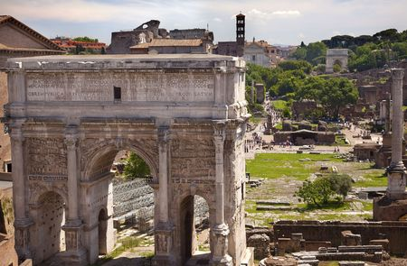 severus: Septemus Severus Arch Forum Rome Italy Stone arch was built in the memory of Emperor Septemus Severus, who reigned from 193-211AD, and his sons  Titus Arch in Distance