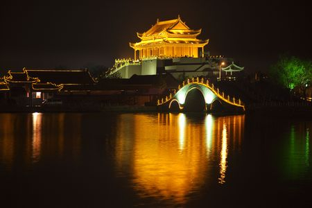song dynasty: Ancient Dragon Pavilion Longting Park Night Reflection Bridge Kaifeng China  Kaifeng was the capital of the Song Dynasty, 1000 to 1100AD.