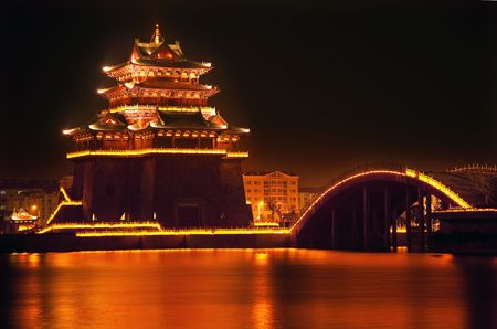 Ancient Temple Night Reflection Bridge Jinming Lake Kaifeng China  Kaifeng was the capital of the Song Dynasty, 1000 to 1100AD. photo