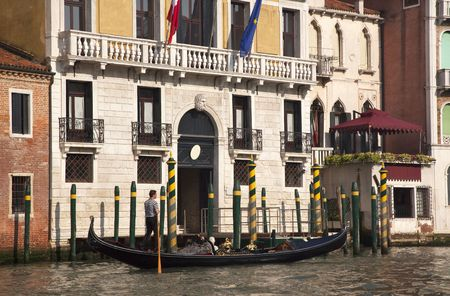 Grand Canal Gondola Gondolier Boat Poles Reflections Venice Italy Trademarks removed.  Gondoliers face blurred. photo
