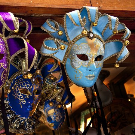 Blue Venetian Masks Venice Italy Used since the 1200s for Carnival, which were celebrated just before Lent.  In ancient times, Masks allowed the Venetians to do what was illegal, such as gambling. photo
