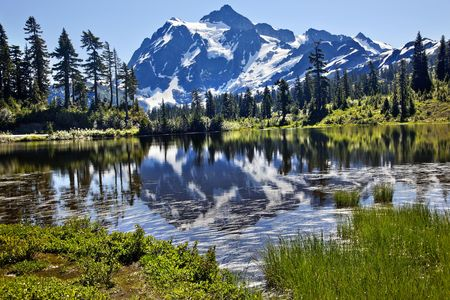 northwest: Reflection Lake Mount Shuksan Mount Baker Highway Snow Mountain Grass Trees Washington State Pacific Northwest Stock Photo