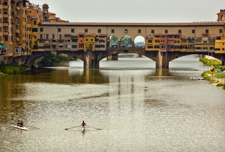 sculling: Rowing, Sculling, Shells Boats on Arno River Ponte Vecchio Covered Bridge Reflection Florence Italy Bridge is the oldest bridge in Florence built in 1345 by Neri di Fioravante