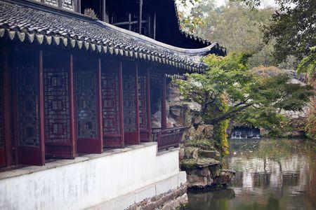 Garden of the Humble Administrator, Zhouzheng Yuan, Reflection Ancient Chinese Houses in Water, Suzhou, Jiangsu, China  Built in the 1500s photo