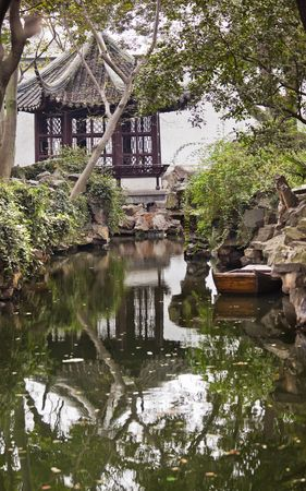 Ancient Chinese Pagoda House, Boat Garden of the Humble Administrator, Zhouzheng Yuan, Reflection Water, Suzhou, Jiangsu, China  Built in the 1500s photo