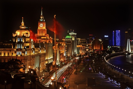 obscured: Shanghai China Bund at Night Cars, Flags Trademarks Obscured Stock Photo